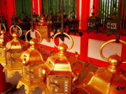 Golden lanterns in an ancient Japanese temple.