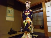 A maiko in her beautiful and ornate kimono.