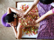 bali ayana resort and spa massage with flowers