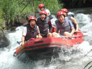 friends on white water rafting adventure in bali
