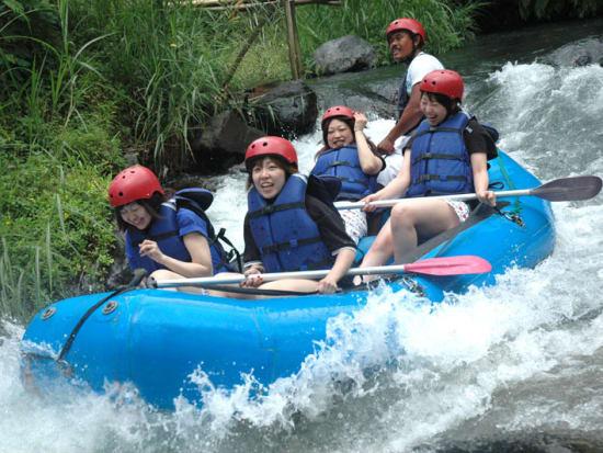 women on rafting adventure in bali indonesia