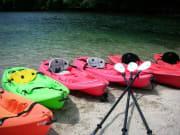 Kayaks resting a sandy spur in Yakushima
