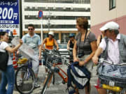 Tourists and locals exploring Kyoto on bicycle