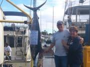 Dan-and-Julie-120-lb-blue-marlin-on-Ruckus-with-Capt-Chris-and-Matt