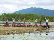 travelers hands stretched in the air ATV quad bike