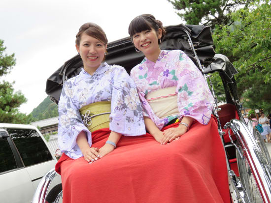 Kimono wearing Japanese women on a rickshaw
