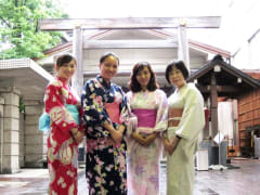 Group posing in yukata, in front of a torii gate