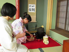 Preparing matcha green tea in a yukata