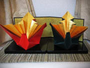 Two colorful gilt origami cranes
