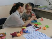 Child learning to make origami art
