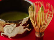 Matcha green tea and traditional whisk