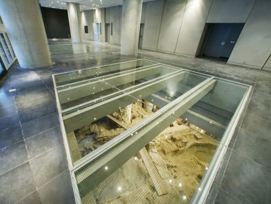 08ViewOfGlassWindowsToArchaeologicalExcavationMuseumGroundFloor