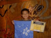 Small kid holding their completed tie-dye