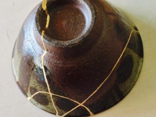 A bowl restored and repaired using gold powder