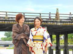 A cute Japanese couple in kimono, walking Kyoto