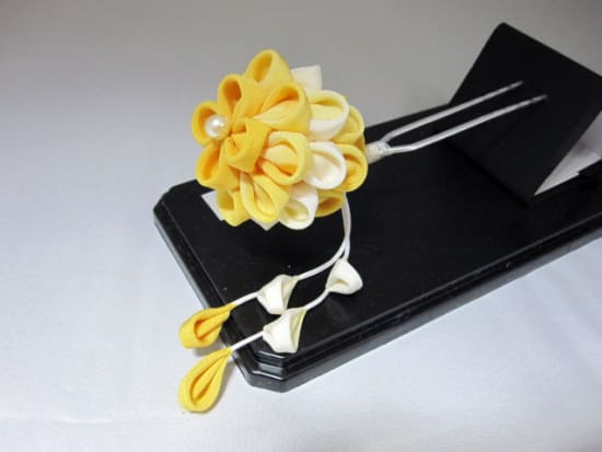 A bright yellow flower styled kanzashi hair piece