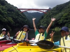 Kayaking near a huge bridge in Yakushima