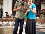 Visitors enjoying the included multimedia guide at St Paul's Cathedral