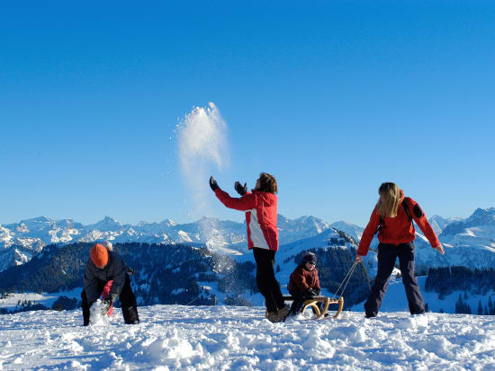 Playing with snow on the Swiss Alps