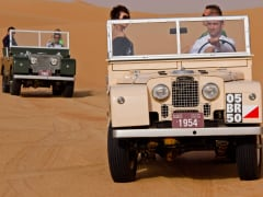 Wildlife desert drive by vintage 1950s Land Rover