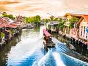 Ride a long-tail boat across the small canals