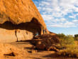 tourists resting at Kitchen Cave in Uluru Ayers