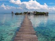 wooden pier to nalusuan island in cebu