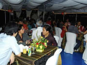 manila bay cruise travelers having dinner