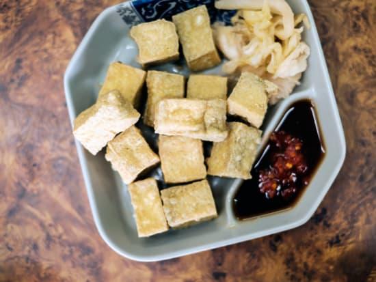 plate of stinky tofu in xinyi district taiwan