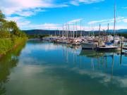 Small sailboats in the harbor in Port Douglas