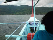 traveler aboard outrigger boat to volcano island