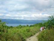 travelers trekking taal volcano in the philippines