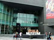 ayala museum signage in white and orange letters