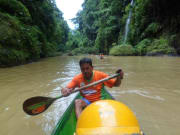 boatman paddling on steady water in pagsanjan