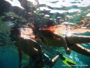 couple snorkeling in the waters of anilao batangas