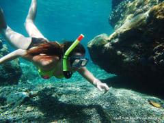 woman snorkeling in anilao batangas philippines