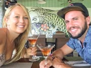 Couple enjoying drinks in Koh Samui