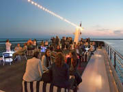 Guests-on-Sundeck-at-Sunset_MdR-Harbor_Gallery
