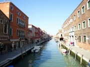 Sail along the Romanesque Murano village