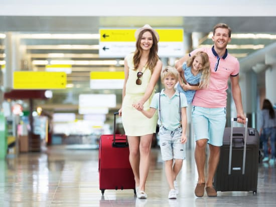 family arriving in bangalore airport india