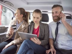 business people inside private vehicle bangalore