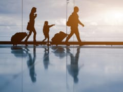 Family with luggage cropped