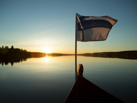 Riverboat cruise under the midnight sun in Lapland