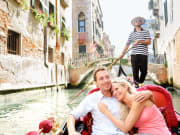 Romantic gondola ride along the canals of Venice