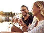 couple enjoying wine in sydney harbour cruise