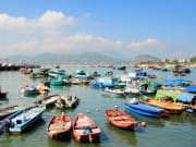 boats docked near the shore in cheung chau island
