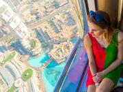 UAE_Dubai_Burj_Khalifa_woman_sitting_shutterstock
