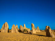 rock formations at pinnacles desert under blue sky
