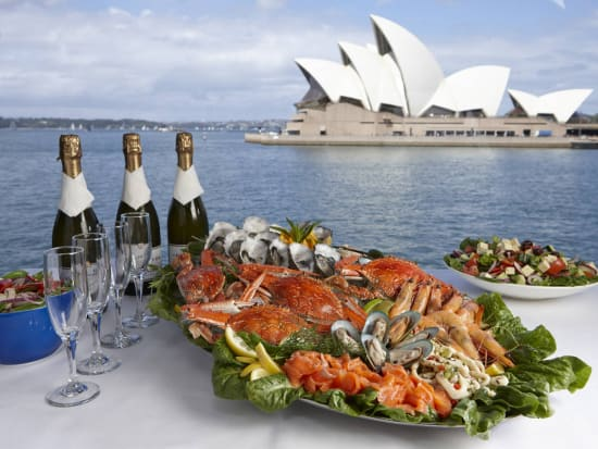 seafood platter and salad with bottles of wine