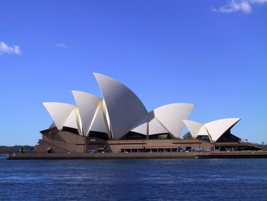 sydney opera house with blue skies and blue sea